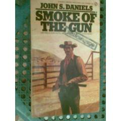 SMOKE OF THE GUN JOHN S.DANIELS